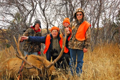 group posing with elk and horns