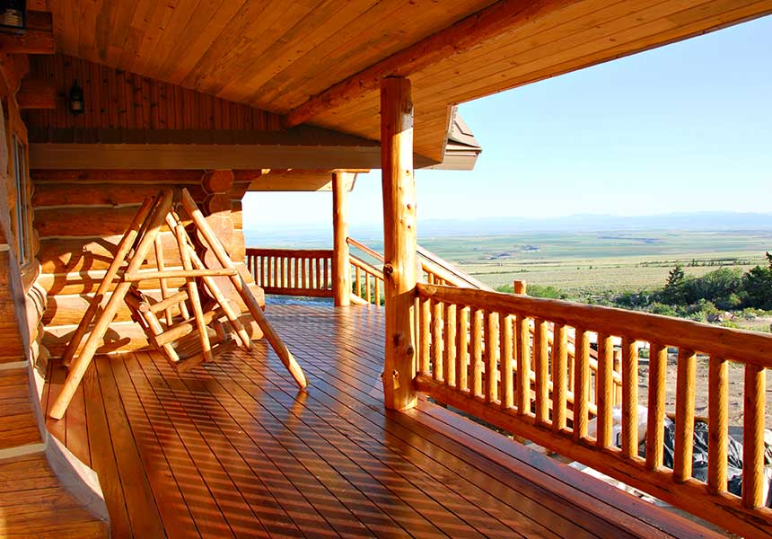 deck with swing and view of hills