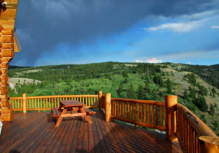 deck with table and view of hills