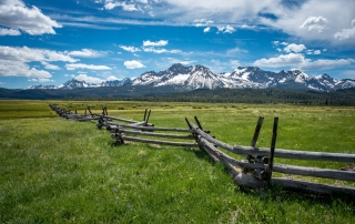 A majestic mountain rests in the background of an Idaho plateau.